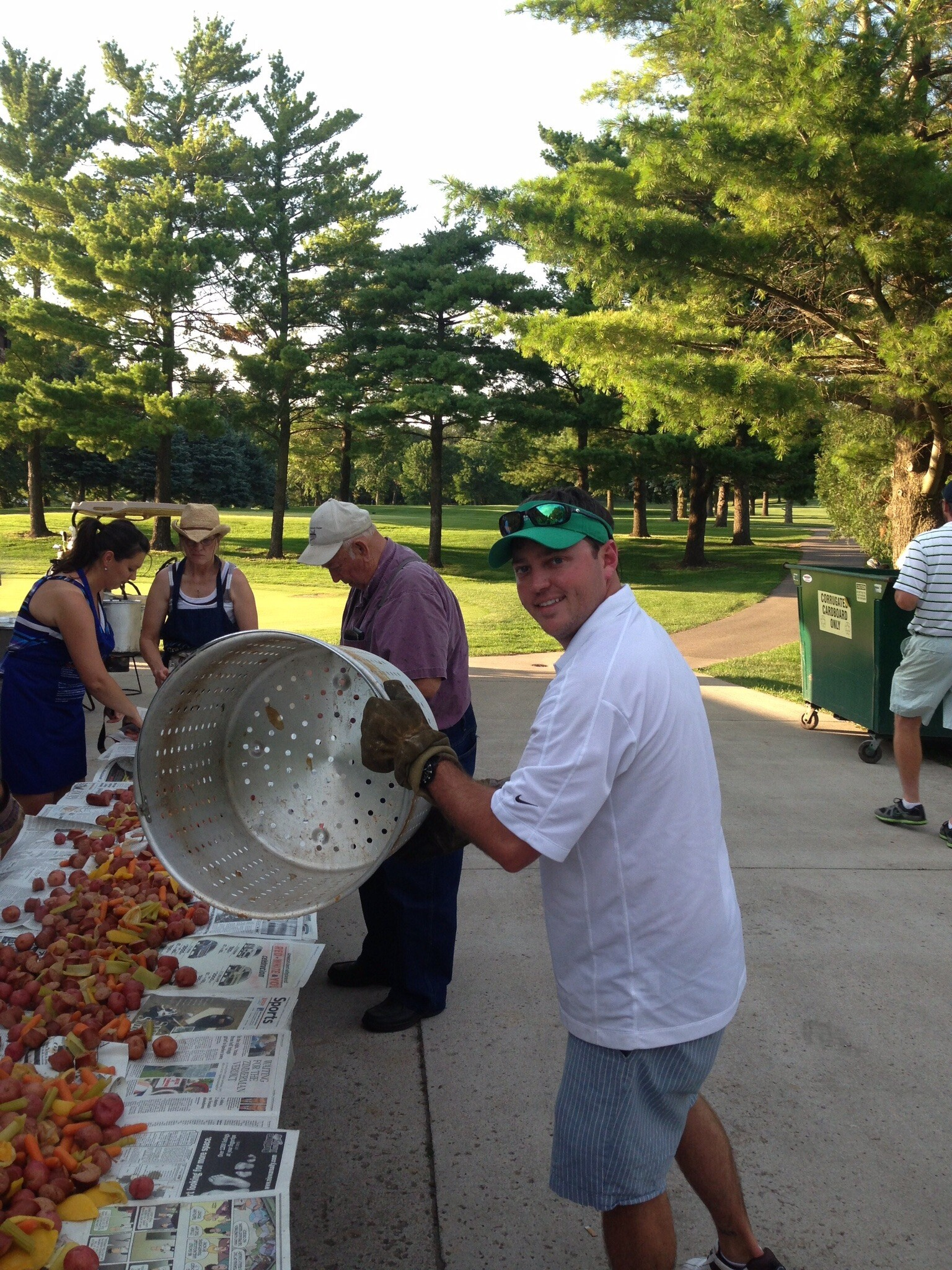 Kenny serving some boiled shrimp at Argo's annual Winnebago shrimp boil in Iowa.