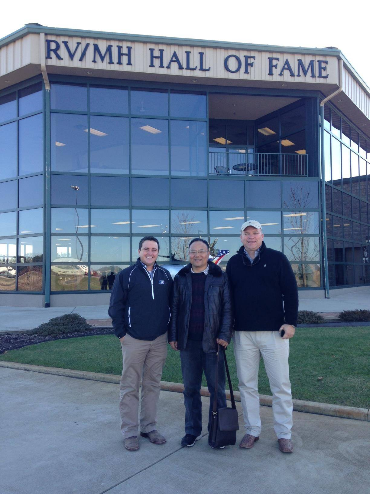 Robert (Left) Todd Wager (far right) with a lumbercore supplier visiting the RV hall of fame in Elkhart, IN
